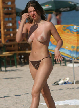 Topless candid beach beauties