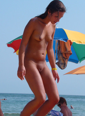 Cute nude and topless girl at the beach