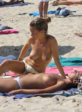 Topless beach girls in bikinis