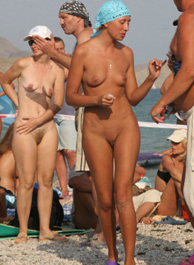 Nudists meet at the beach