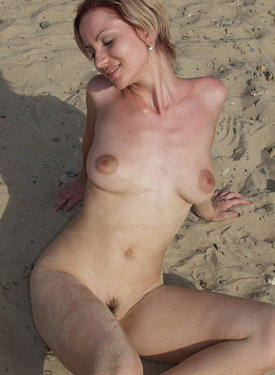 Blonde nude on the beach