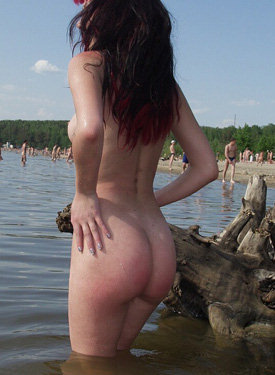 Red head nude in the water