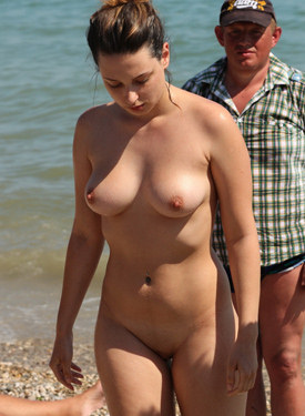 Busty candid nude beach babe