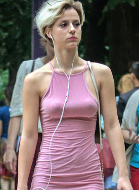Candid girls caught braless on the street