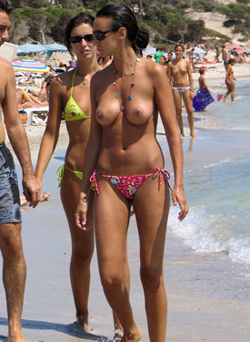Exciting topless girls on the beach