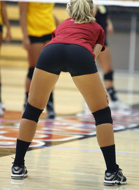 Tight asses playing volleyball